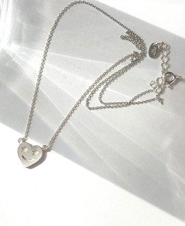 Sterling Silver Star Eyes Heart Necklace  from kellinsilver.com