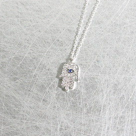 White Gold Sapphire Swarovski Hamsa Evil Eye Necklace Sterling Silver from kellinsilver.com