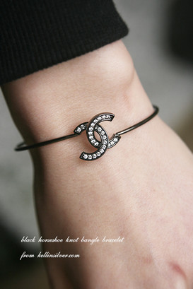 Swarovski Black Horseshoe Knot Bangle Bracelet from kellinsilver.com