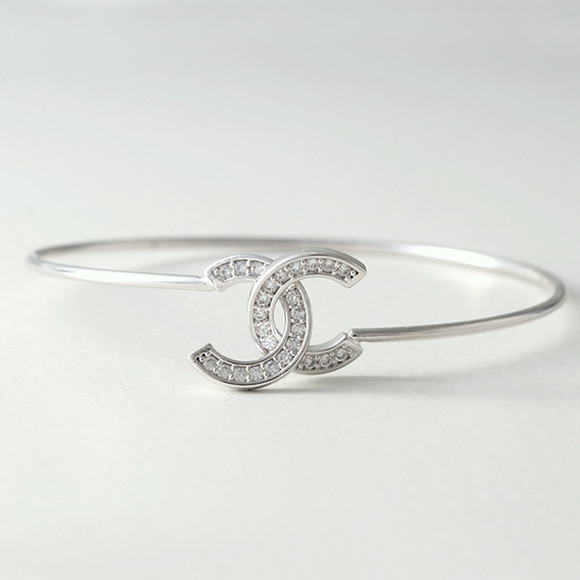 Swarovski White Gold Horseshoe Knot Bangle Bracelet from kellinsilver.com