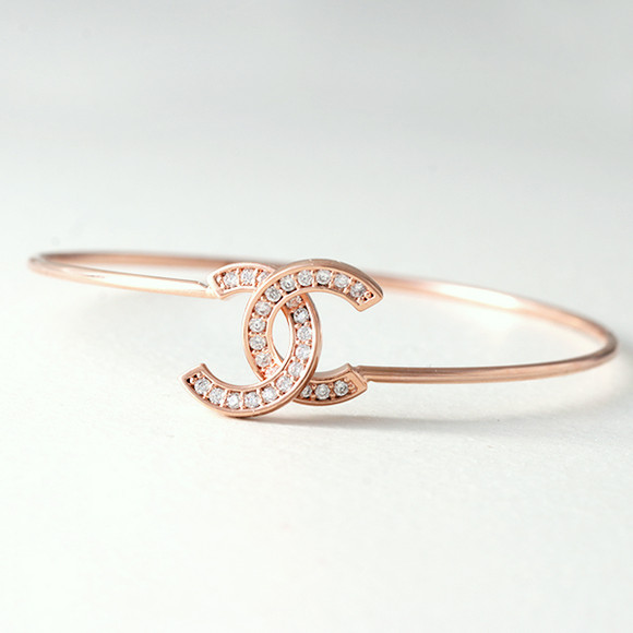 Swarovski Rose Gold Horseshoe Knot Bangle Bracelet from kellinsilver.com