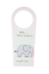 Ssh baby's sleeping elephant door knob hanger with pink trim.