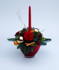 The deluxe classic candle created in a  luxury red  pot, full of festive goodies, foliage and red roses.