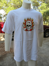 Flaming Skull by Kozik appears on front of t-shirt.