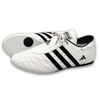 Beloved since its introduction 12 years ago, this classic martial arts shoe has become the standard by which all others are judged. And with good reasonóits fast and simple design allows for the natural movement of the foot through a variety of indoor exercises. White with black stripes.