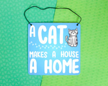 A Cat Makes A House A Home - Metal Sign
