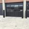 Skyline Decorative Bollard Cover in black protecting garage entrance