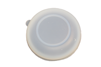 Top view of translucent silicone serving bowl lid.