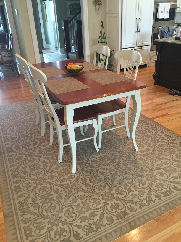 Vintage Vinyl Floor Cloth Used As A Dining Room Rug