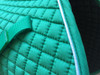 Zoom to teal english saddle pad color (shown here with optional white piping)