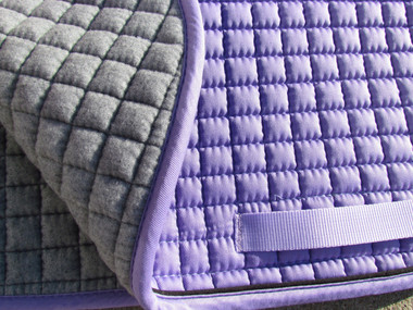 Zoom to view the flannel underside of this lilac/lavender purple dressage saddle pad.
