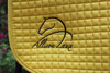 Simple Logo - Embroidered Onto a Yellow All-Purpose Saddle Pad