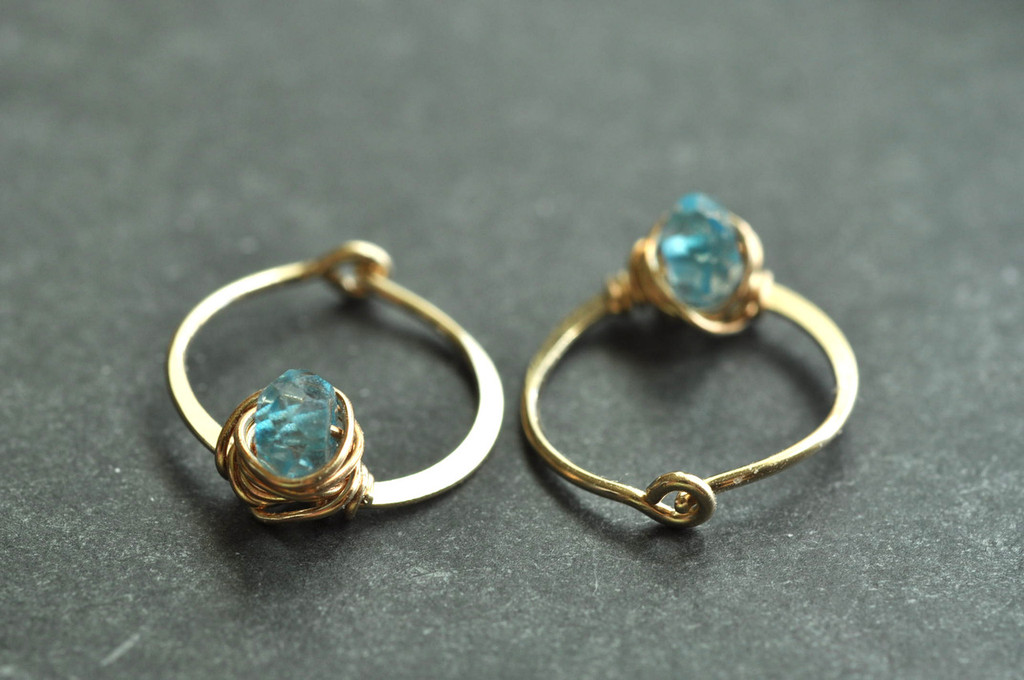 "11mm (7/16"") gold hoops with blue topaz"