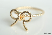 yellow gold bow ring twisted wire