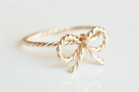 mixed metal bow ring twisted wire