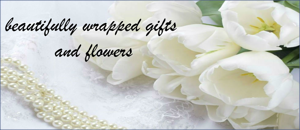 beautifully wrapped gifts and flowers