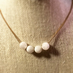 breast milk pearl necklace.