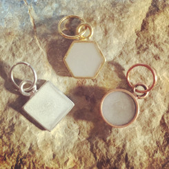 open frame geometric breast milk charm.