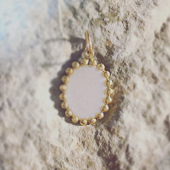 beaded frame breast milk pendant.