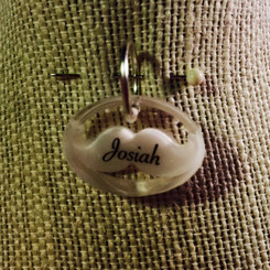 mustache breast milk pendant with name.