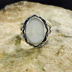 scalloped oval breast milk ring.