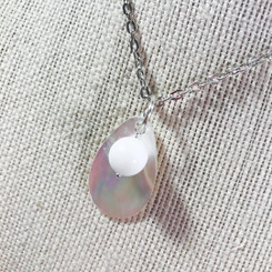 mother of pearl breast milk pendant.
