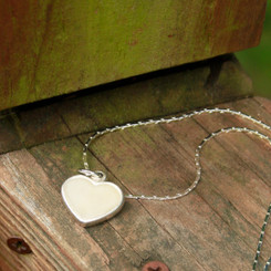 locked heart breast milk charm.
