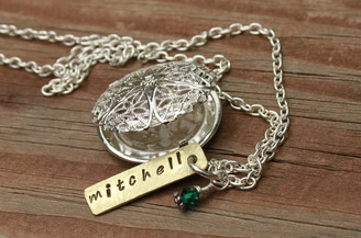 filigree memorial locket.