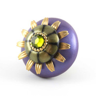Mini Iris knob 2 inches diameter with gold metal details and olivine crystal