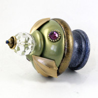 Finial Birdie in jade and light sapphire blue has gold metal accents and amethyst crystals