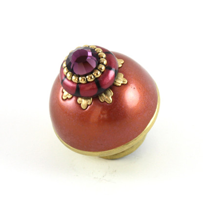 Nu poppy coral 1.5 inches diameter has gold painted stem to complement the metal details