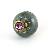 Nu Ivy Knob Turquoise 1.5 Inches Diameter has gold metal details and Swarovski amethyst crystal