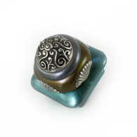 Mini Tudor knob 1.5 in. colored in aqua, bronze and pewter with silver metal accents.