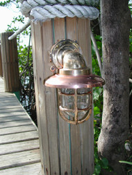 heavy duty medium sized 90 degree bronze dock light with copper hood