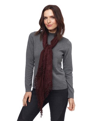 Woman in claret fringed scarf