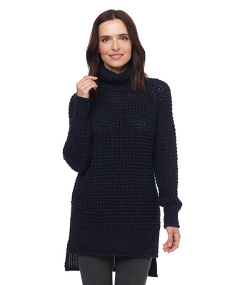 Woman in navy blue high low turtleneck sweater