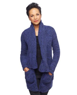 Woman in navy blue long cardigan sweater