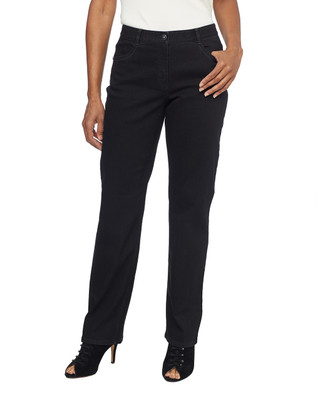Woman in black stretch mid rise jeans
