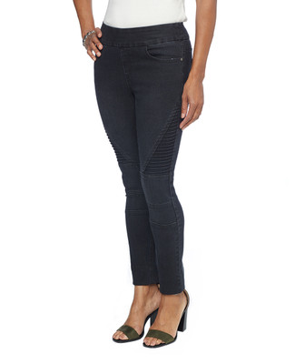 Woman in black skinny moto jeggings