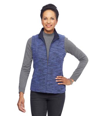 Woman in blue boucle vest