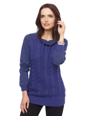 Woman in blue cable knit drawstring sweater