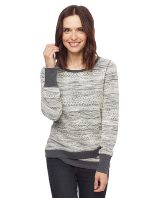 Woman in grey crewneck pullover sweater