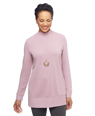 Woman in pink pullover tunic sweater