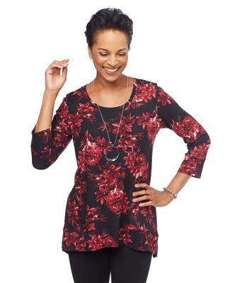 Woman in black floral sharkbite hem tunic