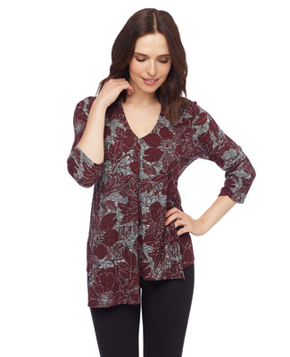 Woman in floral V neck asymmetrical top