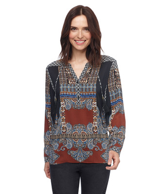 Woman in patterned Y front tasseled popover blouse