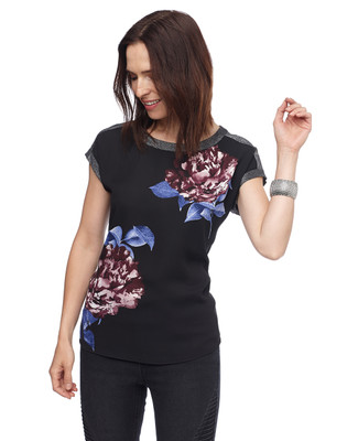 Woman in black floral cap sleeve top