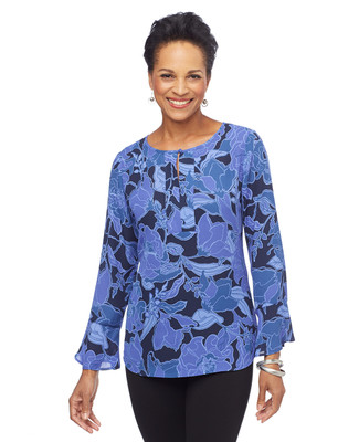 Woman in blue floral bell sleeve tunic