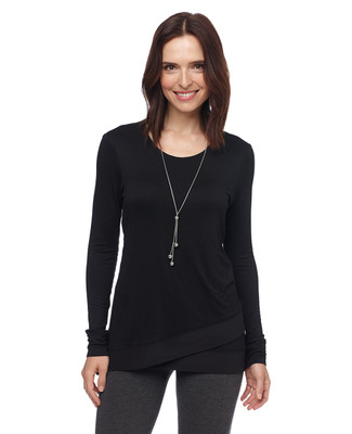 Woman in black asymmetrical tunic sweater