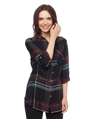 Woman in black plaid belted tunic